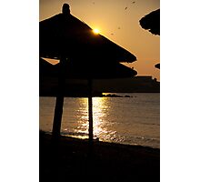 Sunset over umbrellas at the beach Photographic Print
