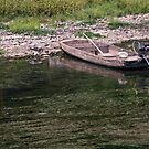 Beached Wooden Boat by phil decocco