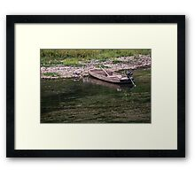 Beached Wooden Boat Framed Print