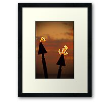Tiki torches at sunset... Framed Print