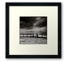 The Boy who stares at the Sea Framed Print
