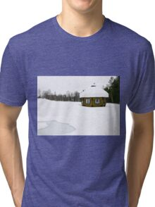 Lapland, Scandinavia, a snow covered wooden sauna shed, in a landscape of snow Tri-blend T-Shirt