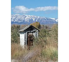 Outhouse with mountain background Photographic Print