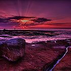 Caught between a rock and a sunrise by GeoffSporne