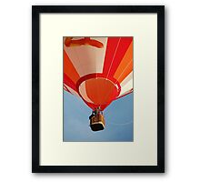 Orange and White Striped Hot Air Balloon in Flight Over Blue Sky Framed Print