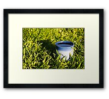 Coffee in the grass Framed Print