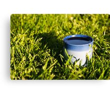 Coffee in the grass Canvas Print