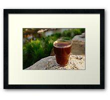 Coffee by a river Framed Print