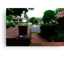 Sipping on the porch Canvas Print