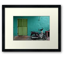 turquoise wall and scooter Framed Print