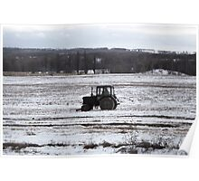 Tractor on the field in winter Poster