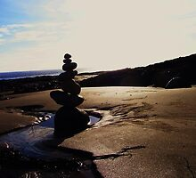 Stacked Stones Sculpture on the Sand by Jamie Evans