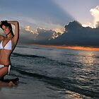 Beautiful brunette bikini model posing at cloudy Caribbean sunrise  by Anton Oparin