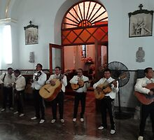 Mariachis in honour of the Virgin - Mariachis honorando la Virgencita by Bernhard Matejka