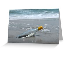 Message in the bottle on the sand and ocean on background Greeting Card
