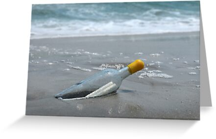 Message in the bottle on the sand and ocean on background by Anton Oparin