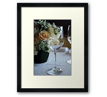 Empty wine glass on decorated restaurant table Framed Print
