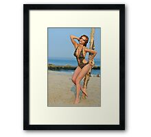 Young redhead girl on the beach standing pretty in designers swimsuit  Framed Print