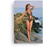 Young redhead girl on the beach standing pretty in designers swimsuit at rocky jetty Canvas Print