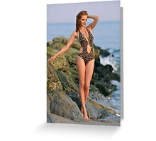 Young redhead girl on the beach standing pretty in designers swimsuit at rocky jetty Greeting Card