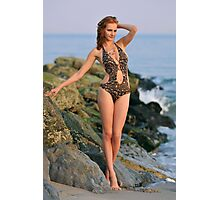 Young redhead girl on the beach standing pretty in designers swimsuit at rocky jetty Photographic Print