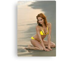 Fashion model in custom design yellow bikini sitting pretty on the sunset beach in Reese Park, NY  Canvas Print