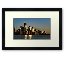 A sunset view of the downtown Manhattan skyline Framed Print