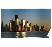 A sunset view of the downtown Manhattan skyline Poster