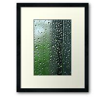 Heavy rain drops on summer window.  Wind of change Framed Print
