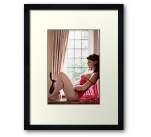 red baby doll Framed Print