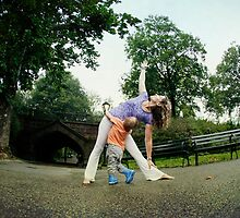 Mom and son practicing Yoga at Central Park, New York by Wari Om  Yoga Photography