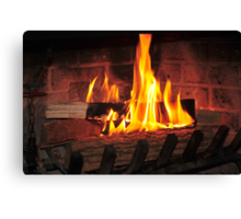 Burning fire at fireplace. Can be used as background. Canvas Print