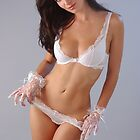 portrait of elegant brunette woman in sexy lingerie by Anton Oparin