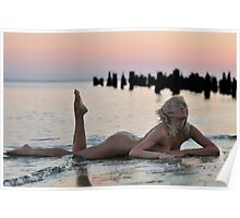 Lovely blond naked model lying on sunset beach at dramatic sunset  Poster