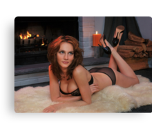Beautiful redhead in lingerie laying in front of  fireplace Canvas Print