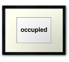 occupied Framed Print