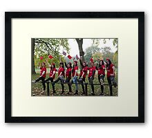 Chinese ladies pose with their legs on a railing in the mall  Framed Print