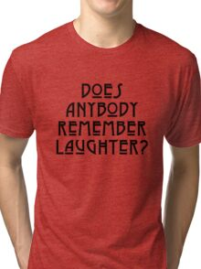 DOES ANYBODY REMEMBER LAUGHTER? solid black Tri-blend T-Shirt
