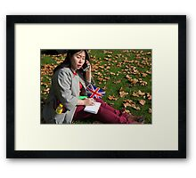 Chinese journalist on her phone Framed Print