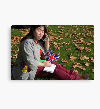 Chinese journalist on her phone Canvas Print