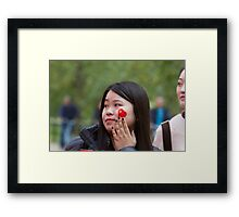 Chinese lady with a flag sticker on her face in the Mall Framed Print