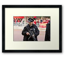 Armed Policeman on duty in the Mall Framed Print