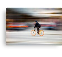Cyclist in motion Canvas Print