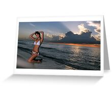Beautiful brunette posing in a water at sunrise in Miami beach, Florida  Greeting Card