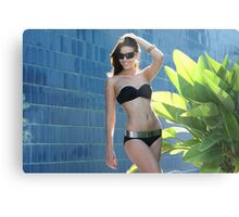 Portrait of a seductive female model in bikini posing in front of blue wall Metal Print