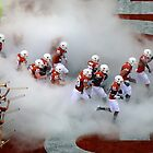 The Texas Longhorns Take The Field by Ray Chiarello