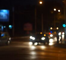 Night road in the city with abstract motion blur of lights by vladromensky