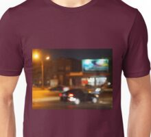Abstract blurred image of a car driving in the city Unisex T-Shirt