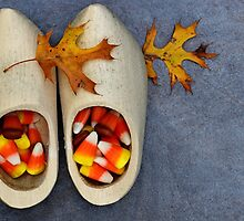 Wooden Dutch shoes with candy corn and oak leaves. by Dipali S