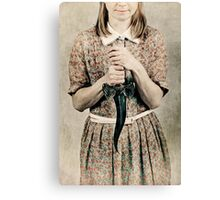 Female holding a curved knife Canvas Print